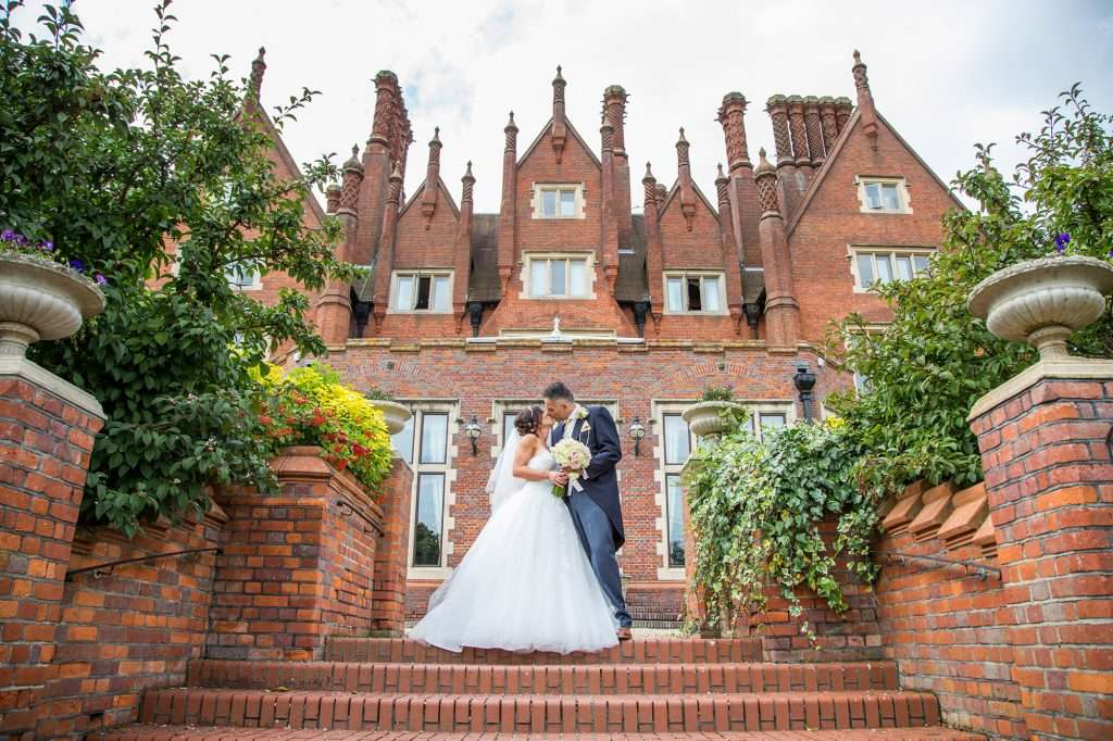 Bride & Groom on the terrace at Dunston Hall Hotel in Norfolk