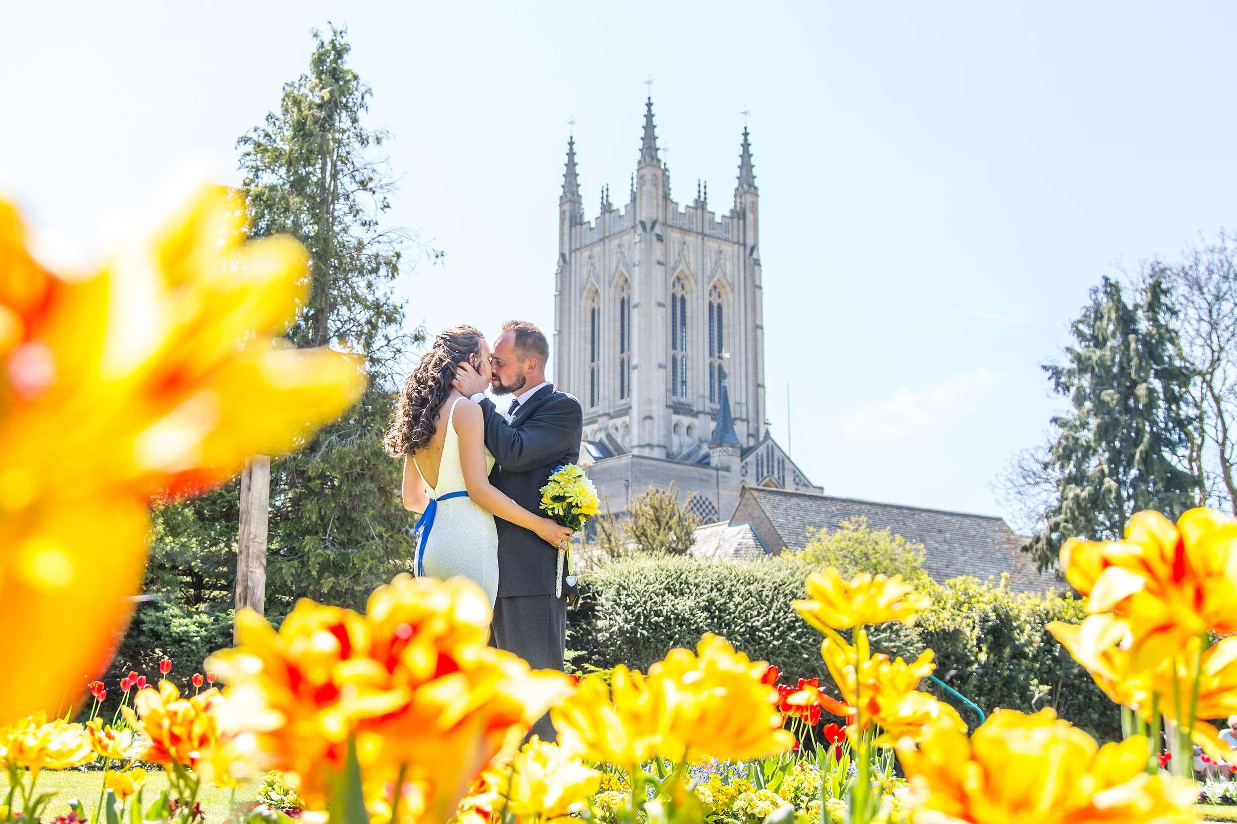 Bride & Groom kissing in Abbey Gardens in Bury St Edmunds in Suffolk