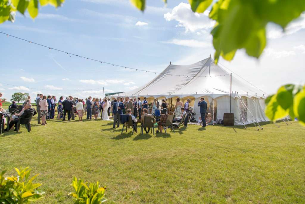 Wedding marquee filled with guests at Low Barn Farm Fundenhall in Norfolk