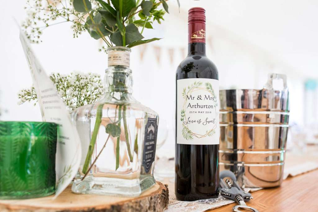 Personalised wine bottle for the new Mr & Mrs Arthurton on the top table at their wedding at Low Barn Farm Fundenhall.