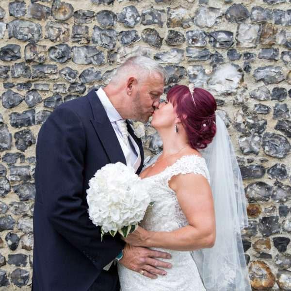 Birde & Groom kissing outside church