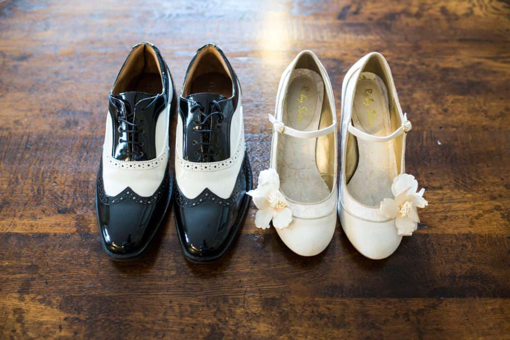 Bride & Groom's wedding day shoes next to each other