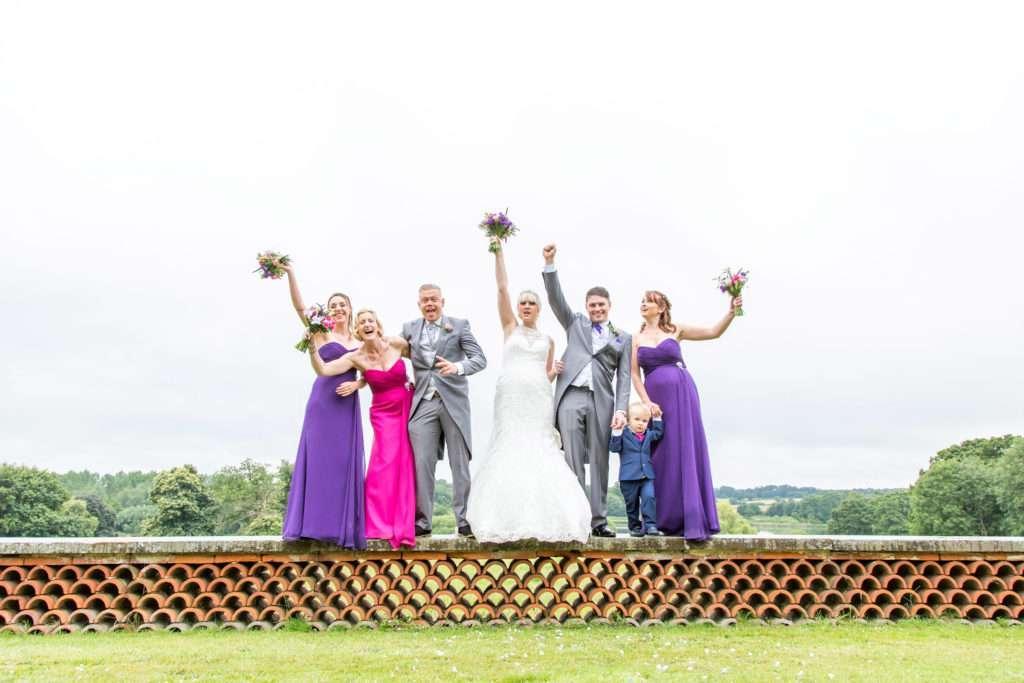 Bridal party stood on the wall at Kimberley Hall