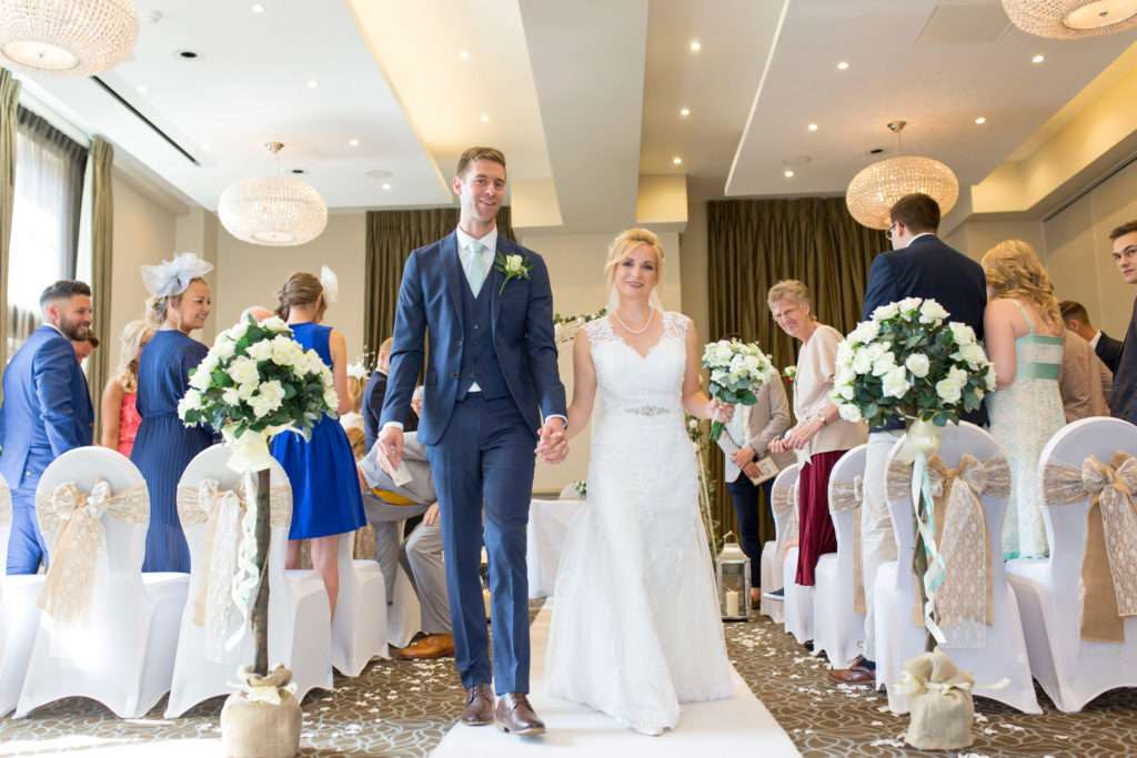 Bride & Groom walking down the aisle after their wedding ceremony at Bedford Lodge in Newmarket, Suffolk