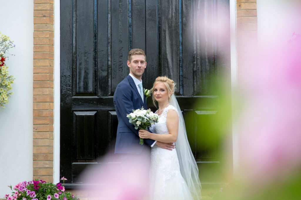 Bride & Groom in the gardens at Bedford Lodge in Newmarket, Suffolk