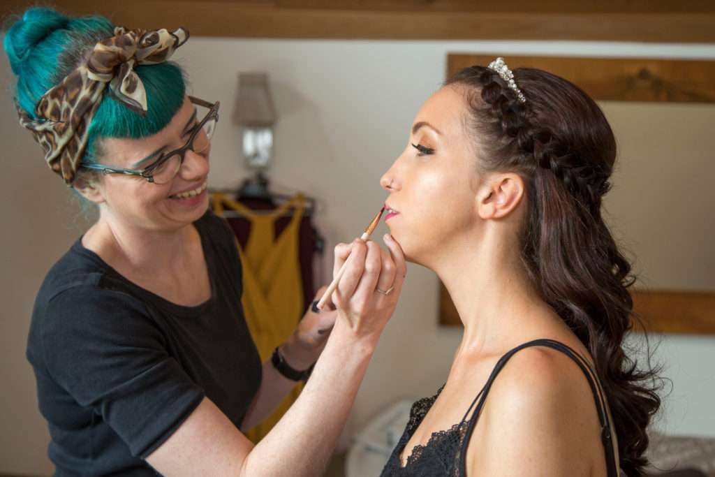 Flamingo Amy MUA applying brides lipstick at The Boat House in Norfolk