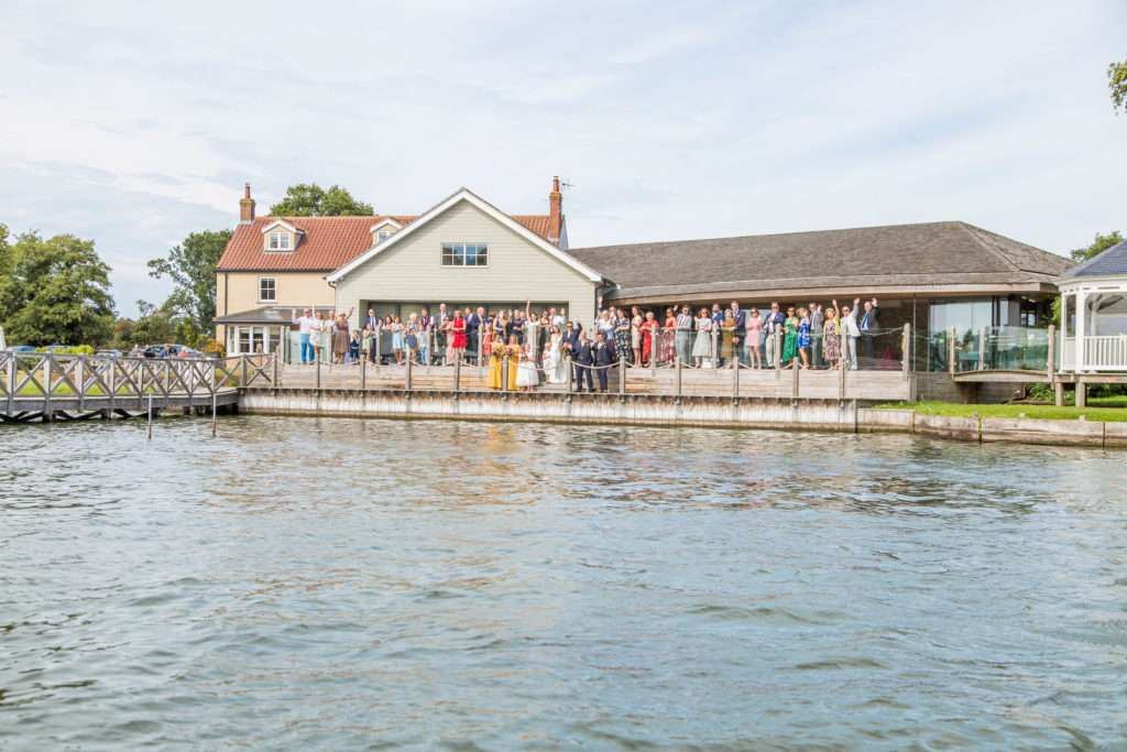 Guests on the boardwalk at a wedding at The Boat House in Norfolk.