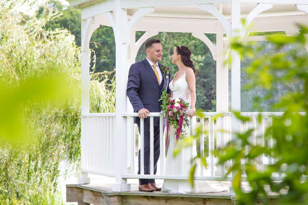 Bride & Groom on the pagoda on their wedding day at The Boat House in Norfolk