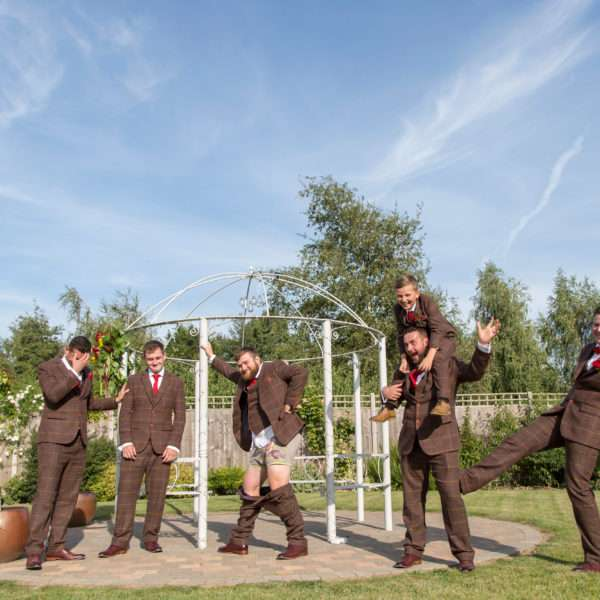 Groom & Grooms party being silly on the pagoda at Applewood Hall in Norfolk