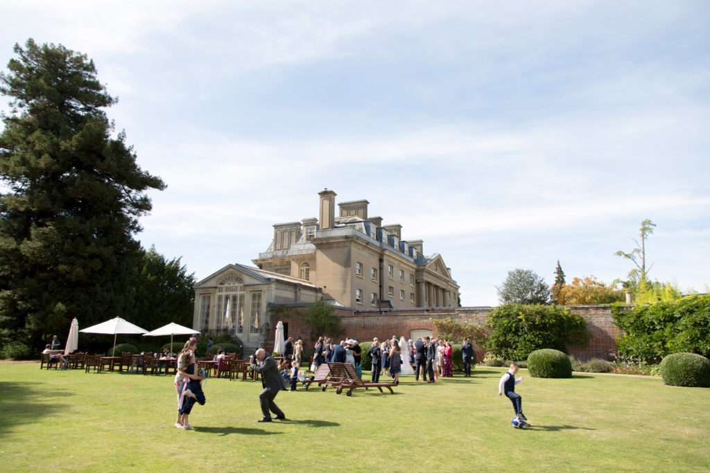 Guests at a wedding on the lawn at Ickworth Hotel in Suffolk
