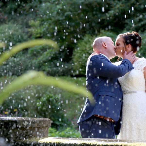 Bride & Groom kissing in Plantation Gardens in Norwich city centre near the fountain