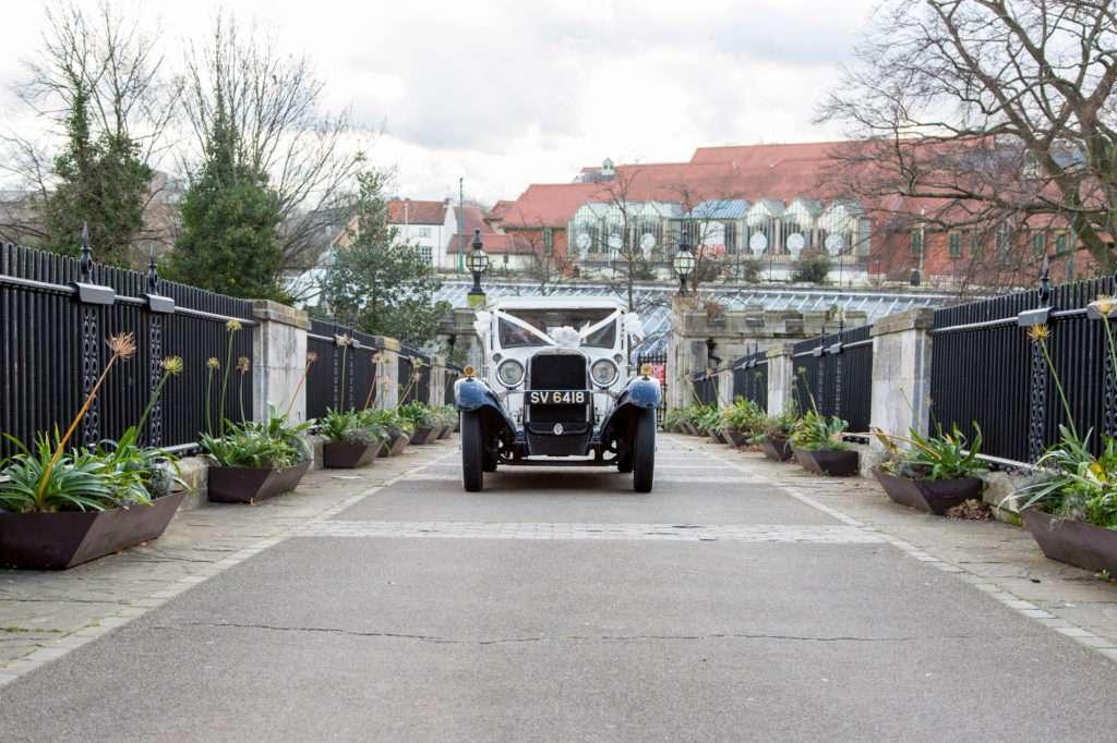 Dodge wedding car driving towards Norwich Castle