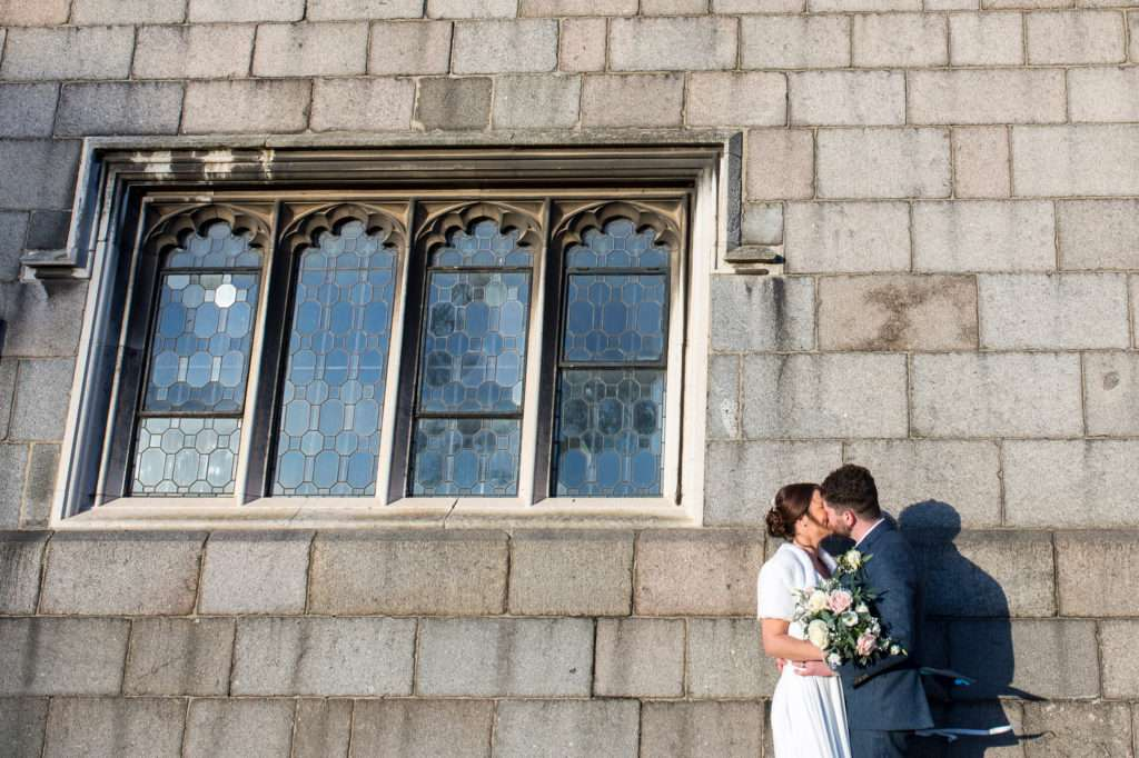 Bride & Groom kissing outside Norwich Castle