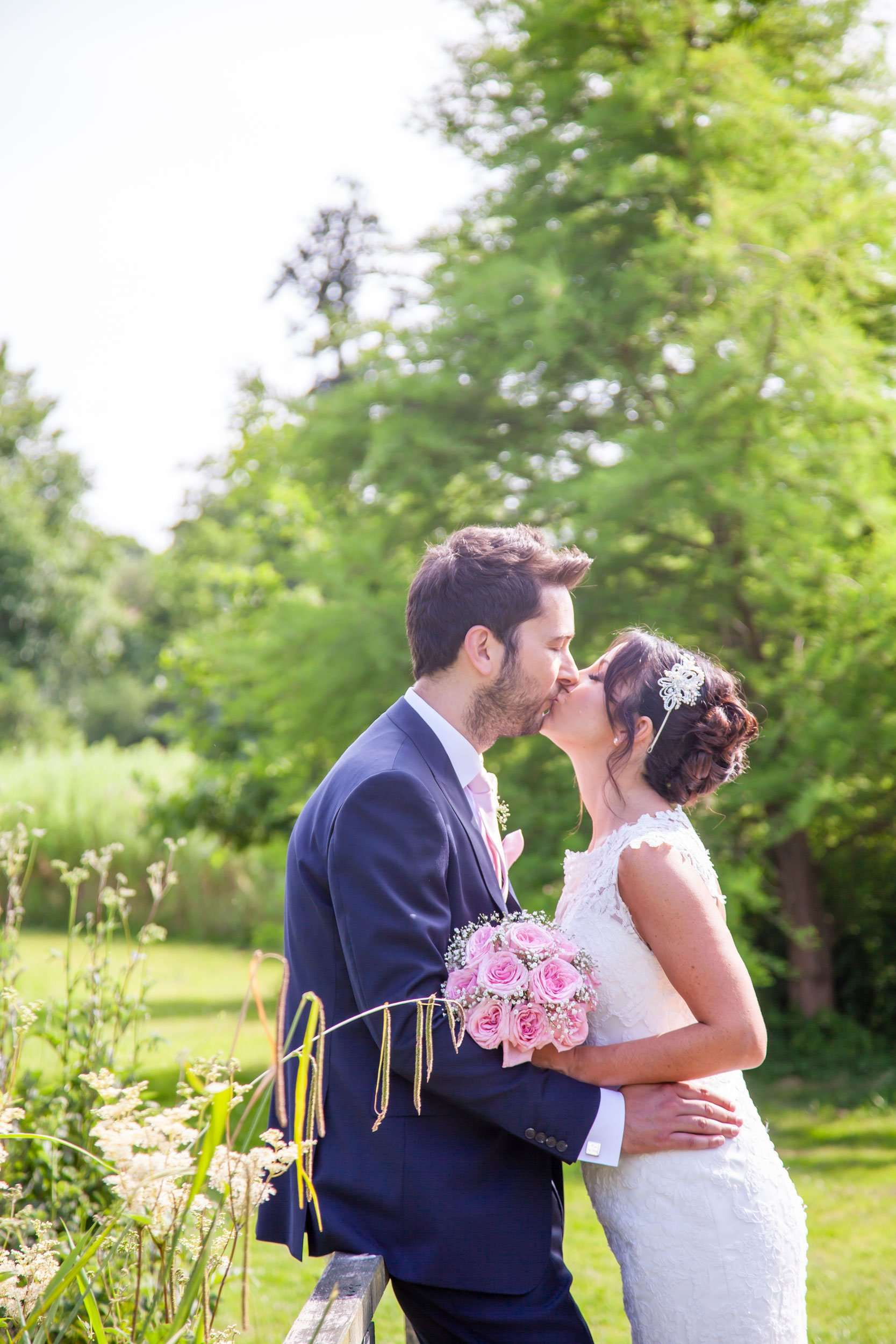 Bride & Groom kissing in the garden at Norfolk Mead Hotel