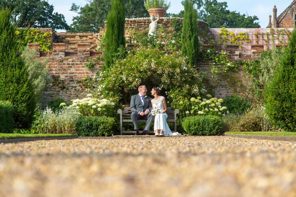 Husband & Wife sharing a kiss at Oxnead Hall in Norfolk