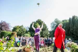 Throwing the bouquet at a wedding at Hockwold Hall in Norfolk
